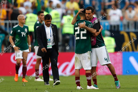 Mexico's Rafael Marquez, right, hugs team mate Hirving Lozano after the round of 16 match between Brazil and Mexico at the 2018 soccer World Cup in the Samara Arena, in Samara, Russia