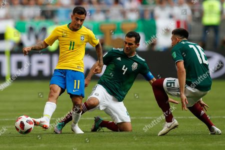 Brazil's Philippe Coutinho, left, Mexico's Rafael Marquez, center, and Mexico's Hector Herrera, right, challenge for the ball during the round of 16 match between Brazil and Mexico at the 2018 soccer World Cup in the Samara Arena, in Samara, Russia