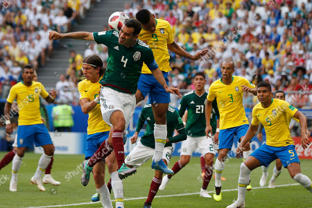 Mexico's Rafael Marquez, left, and Brazil's Gabriel Jesus challenge for the ball during the round of 16 match between Brazil and Mexico at the 2018 soccer World Cup in the Samara Arena, in Samara, Russia