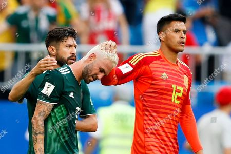 Mexico goalkeeper Alfredo Talavera, right, comforts teammates Miguel Layun after their 0-2 lost in the round of 16 match against Brazil at the 2018 soccer World Cup in the Samara Arena, in Samara, Russia