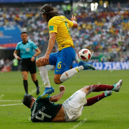 Brazil's Filipe Luis jumps over Mexico's Rafael Marquez during the round of 16 match between Brazil and Mexico at the 2018 soccer World Cup in the Samara Arena, in Samara, Russia