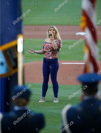 Stock Picture of Ariel Rose sings the National Anthem before the start of a baseball game between the Miami Marlins and the Tampa Bay Rays, in Miami