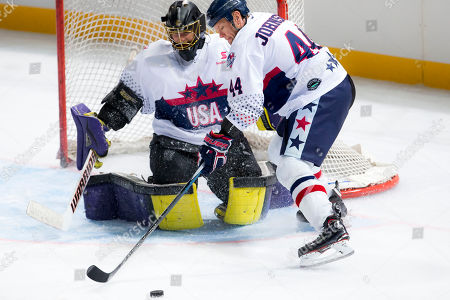 USA player Aaron Johnson (44) clears the puck from danger at the 2018 Ice Hockey Classic between USA and Canada at Qudos Bank Arena in Sydney