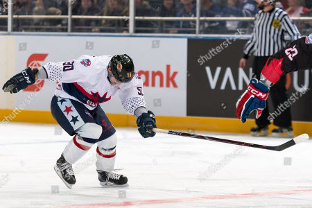 USA player John Dunbar (90) chases the puck at the 2018 Ice Hockey Classic between USA and Canada at Qudos Bank Arena in Sydney.