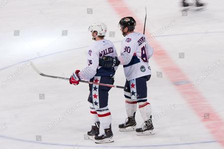 USA player Nathan Walker (79) and USA player John Dunbar (90) at the 2018 Ice Hockey Classic between USA and Canada at Qudos Bank Arena in Sydney.