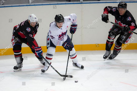 Stock Picture of USA player Shane Brennan (91) and Canada Player Kyle Baun (12) battle for the puck at the 2018 Ice Hockey Classic between USA and Canada at Qudos Bank Arena in Sydney