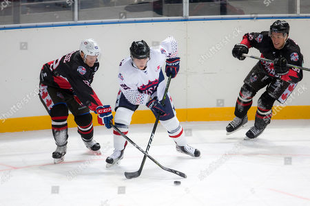 Stock Photo of USA player Shane Brennan (91) battles for the puck at the 2018 Ice Hockey Classic between USA and Canada at Qudos Bank Arena in Sydney