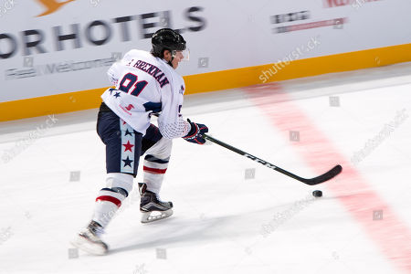Stock Photo of USA player Shane Brennan (91) controls the puck at the 2018 Ice Hockey Classic between USA and Canada at Qudos Bank Arena in Sydney.