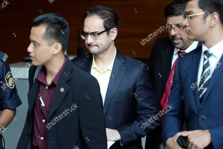 Riza Aziz, center, stepson of Malaysian former Prime Minister Najib Razak, arrives at Anti-Corruption Agency in Putrajaya, Malaysia, . Riza appears before the Malaysian Anti-Corruption Commission to give statement related to the 1MDB investigation