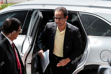 Riza Aziz, right, stepson of Malaysian former Prime Minister Najib Razak, arrives at Anti-Corruption Agency in Putrajaya, Malaysia, . Riza appears before the Malaysian Anti-Corruption Commission to give statement related to the 1MDB investigation