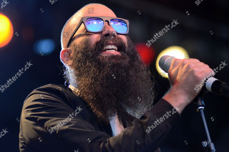 Stock Photo of Singer Sebu Simonian of the band Capital Cities performs live at Henry Maier Festival Park during Summerfest in Milwaukee, Wisconsin