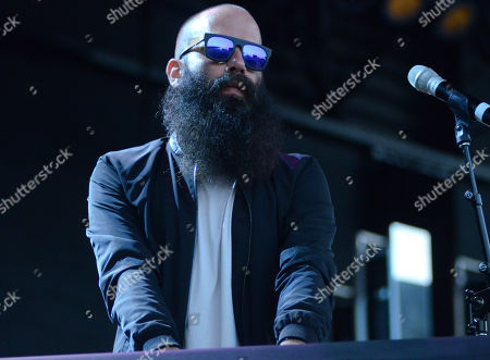 Singer Sebu Simonian of the band Capital Cities performs live at Henry Maier Festival Park during Summerfest in Milwaukee, Wisconsin