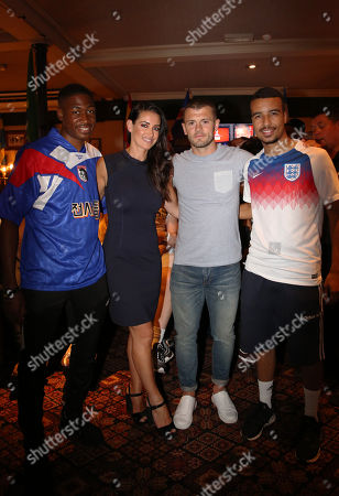 Jack Wilshere and Kirsty Gallacher watch England v Colombia match with fans in The William Hill Arms Pub in London