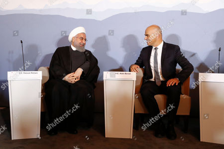 Swiss Federal President Alain Berset (R) and Iranian President Hassan Rohani (L) during an innovation and industry forum during Rohani's official visit to Switzerland in Bern, Switzerland, 03 July 2018. Rouhani is on a two-days visit to Switzerland.