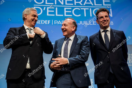 French employers' association Medef head Pierre Gattaz (C) poses with Geoffroy Roux de Bezieux (R) and Alexandre Saubot (L), candidates for the election as new head of the association of the French employers, pose in Paris, France, 03 July 2018. Gattaz was the president of the employers' association in the last five years.