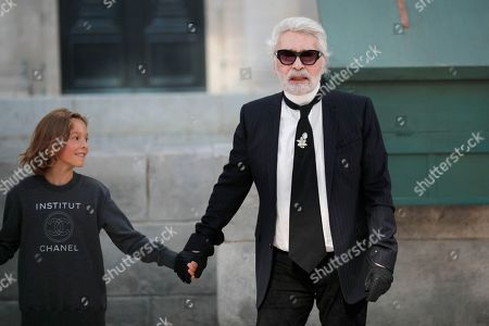 Karl Lagerfeld, Hudson Kroenig. Designer Karl Lagerfeld, right, holds the hand of model Hudson Kroenig after the Chanel Haute Couture Fall-Winter 2018/2019 fashion collection presented in Paris