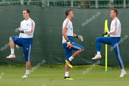 Igor Akinfeev, Andrei Lunyov, Vladimir Gabulov. Russia goalkeepers Andrei Lunyov, left, Vladimir Gabulov, centre, and Igor Akinfeev, right, take part in a training session at the 2018 soccer World Cup, at the Federal Sports Centre Novogorsk, near Moscow, Russia, . Russia are preparing for a World Cup quarterfinal against Croatia in Sochi on Saturday July 7