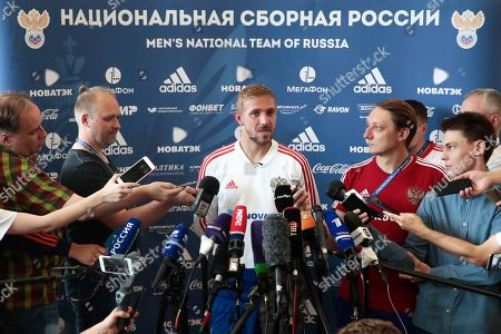 Russia's Yuri Gazinsky, centre, speaks with the press after a training session at the 2018 soccer World Cup, at the Federal Sports Centre Novogorsk, near Moscow, Russia, . Russia are preparing for a World Cup quarterfinal against Croatia in Sochi on Saturday July 7