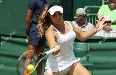 Gabriella Taylor of Great Britain returns to Eugenie Bouchard of Canada during their first round match during the Wimbledon Championships at the All England Lawn Tennis Club, in London, Britain, 03 July 2018.