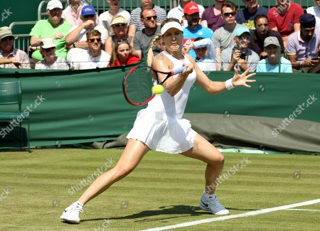 Eugenie Bouchard of Canada returns to Gabriella Taylor of Great Britain during their first round match during the Wimbledon Championships at the All England Lawn Tennis Club, in London, Britain, 03 July 2018.