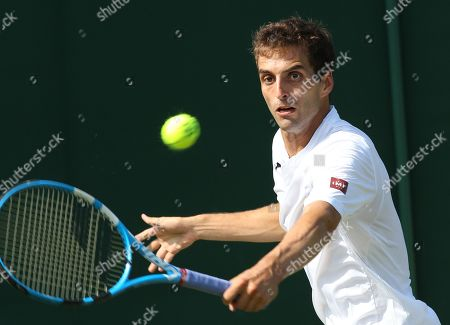 Albert Ramos Vinolas returns to Stephane Robert of France during their first round match during the Wimbledon Championships at the All England Lawn Tennis Club, in London, Britain, 03 July 2018.