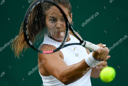 Daria Kasatkina of Russia returns to Jana Fett of Croatia during their first round match during the Wimbledon Championships at the All England Lawn Tennis Club, in London, Britain, 03 July 2018.