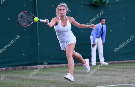 Jana Fett of Croatia returns to Daria Kasatkina of Russia during her first round match during the Wimbledon Championships at the All England Lawn Tennis Club, in London, Britain, 03 July 2018.