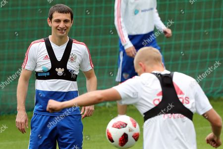 Russian player  Alan Dzagoev (L) attends a training session held at the Federal Sports Centre Novogorsk, Novogorsk, Russian Federation, 03 July 2018. Russia will face Croatia on 07 July in a quarter final match of the FIFA World Cup 2018.