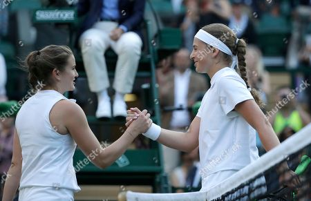 Latvia's Jelena Ostapenko, right, shakes hands with Britain's Katy Dunne after defeating her in their women's singles match, on the second day of the Wimbledon Tennis Championships in London