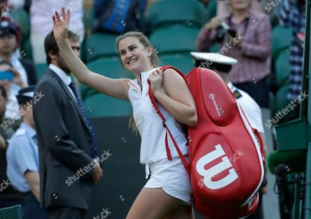 Britain's Katy Dunne leaves the court after loosing to Latvia's Jelena Ostapenko in their women's singles match, on the second day of the Wimbledon Tennis Championships in London