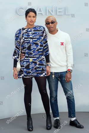 Pharrell Williams (R) and Helen Lasichanh (L)
