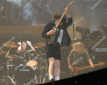 Atlanta Ga - October 23: Phil Rudd Angus Young and Cliff Williams of Ac/dc Perform at Philips Arena On October 23 2009 in Atlanta Georgia United States Atlanta