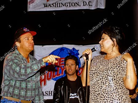 Washington Dc Usa October 3 1993 Comedian Roseanne Barr Pictured with Tom Arnold Performs On Stage the Grand Opening of the Planet Hollywood Night Club with Tom Arnold (l) United States Washington