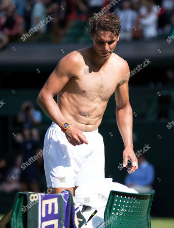 Rafael Nadal (ESP) changes his shirt after his first round win against  Dudi Sela (ISR), Wimbledon Championships 2018, Day Two, All England Lawn Tennis & Croquet Club, Church Rd, London, United Kingdom - 3rd July 2018