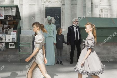 Karl Lagerfeld, Hudson Kroenig and Adut Akech on the catwalk