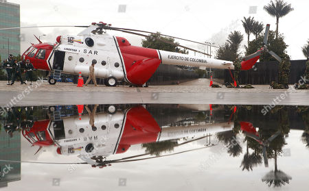 The helicopter used in 'Operation Jaque' is reflected in the water during the commemoration of the 10 years of the operation, at the Monument to the Fallen, in Bogota, Colombia, 03 July 2018. On 02 July 2008, in a jungle area of southeastern Colombia, the Army rescued 15 people kidnapped by the FARC in 'Operation Jaque', a cinematographic military maneuver that a decade later is still considered 'perfect'. Without firing a single shot, former Colombian presidential candidate Ingrid Betancourt, US contractors Thomas Howes, Marc Gonsalves and Keith Stansell, and eleven soldiers and policemen, some of whom had been in the hands of the FARC for more than 10 years, were rescued.