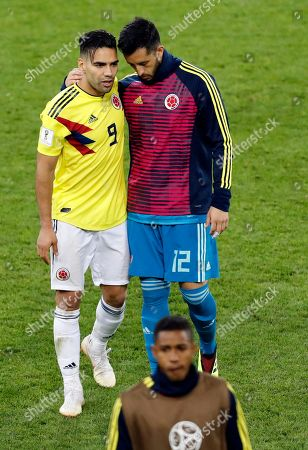 Colombia's Radamel Falcao, left, and Colombia goalkeeper Camilo Vargas leave the field at the end of the round of 16 match between Colombia and England at the 2018 soccer World Cup in the Spartak Stadium, in Moscow, Russia