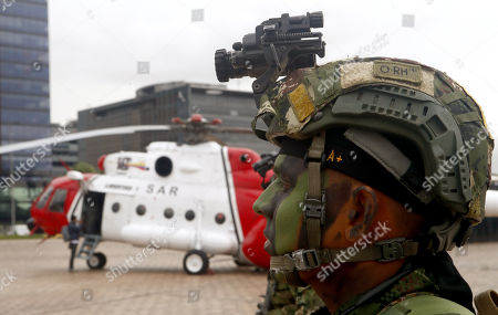 A soldier stands guard in front of the helicopter used in 'Operation Jaque' during the celebration of a commemoration of the 10 years of the 'Operation Jaque', at the Monument to the Fallen, in Bogota, Colombia, 03 July 2018. On 02 July 2008, in a jungle area of southeastern Colombia, the Army rescued 15 kidnapped by the FARC in 'Operation Jaque'. Without firing a single shot, former Colombian presidential candidate Ingrid Betancourt, US contractors Thomas Howes, Marc Gonsalves and Keith Stansell, and eleven soldiers and policemen, some of whom had been in the hands of the FARC for more than 10 years, were rescued.