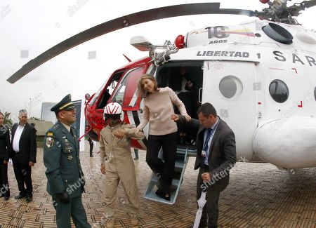 The First Lady of Colombia Maria Clemencia Rodriguez (C) gets out of the helicopter used in 'Operation Jaque' during the celebration of a commemoration of the 10 years of the 'Operation Jaque', at the Monument to the Fallen, in Bogota, Colombia, 03 July 2018. On 02 July 2008, in a jungle area of southeastern Colombia, the Army rescued 15 kidnapped by the FARC in 'Operation Jaque'. Without firing a single shot, former Colombian presidential candidate Ingrid Betancourt, US contractors Thomas Howes, Marc Gonsalves and Keith Stansell, and eleven soldiers and policemen, some of whom had been in the hands of the FARC for more than 10 years, were rescued.