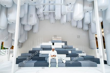 Artist Daniel Arsham, one of the founders of the collaborative practice Snarkitecture, sits in the firm's  exhibition Fun House, the latest of the 'Summer Block Party' installations at the National Building Museum in Washington, DC, USA, 03 July 2018. The heart of the exhibit, which opens 04 July, is a freestanding structure that 'recalls and re-imagines the idea of the traditional home.'