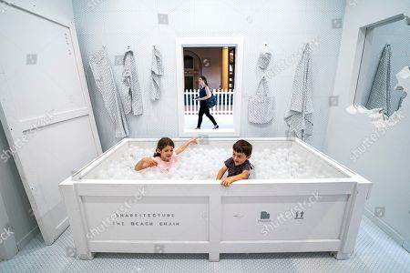 Sarah Smith (L) and Adam Smith (R) play in the exhibit Fun House, the latest of the 'Summer Block Party' installations at the National Building Museum in Washington, DC, USA, 03 July 2018. The heart of the exhibit, which officially opens 04 July, is a freestanding structure that 'recalls and re-imagines the idea of the traditional home.'