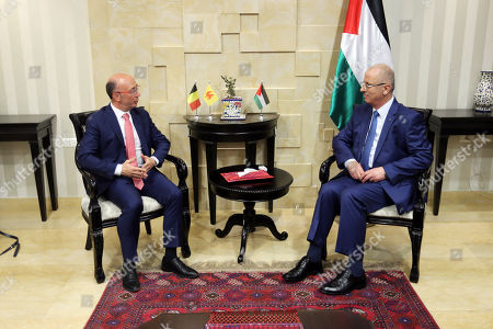 Palestinian Prime Minister Rami Hamdallah meets with Prime Minister of the Belgian province of Wallonia Rudy Demotte, in the West Bank city of Ramallah on July 3, 2018.