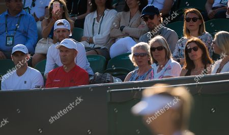 Alexander Gilkes watches Maria Sharapova during her first-round match