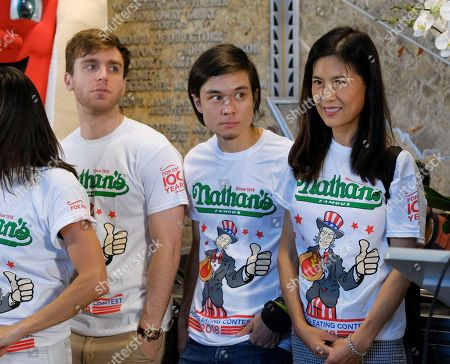 Carmen Cincotti, Matt Stonie, Juliet Lee. Competitive eaters Carmen Cincotti, left, Matt Stonie and Juliet Lee participate in Nathan's Famous International Fourth of July Hot Dog Eating Contest weigh-in at the Empire State Building, in New York