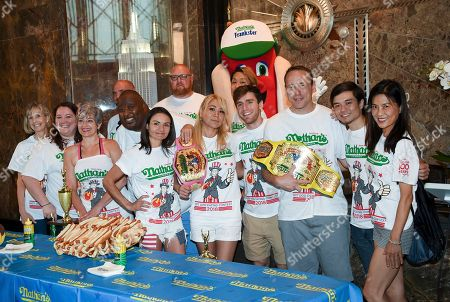 Rene Rovtar, Kristina Rovtar, Tracie Dickerson, Michelle Lesco, Derek Jacobs, Miki Sudo, Carmen Cincotti, Joey Chestnut, Matt Stonie, Juliet Lee. Competitive eaters group shot, including from left, Rene Rovtar, Kristina Rovtar, Tracie Dickerson, Michelle Lesco, Derek Jacobs, Miki Sudo, Carmen Cincotti, Joey Chestnut, Matt Stonie and Juliet Lee during Nathan's Famous International Fourth of July Hot Dog Eating Contest weigh-in at the Empire State Building, in New York
