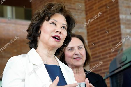 U.S. Transportation Secretary Elaine L. Chao answers questions in Omaha, Neb., as she stands with Sen. Deb Fischer, R-Neb., following an announcement that the Department of Transportation will launch a pilot program to permit 18-20 year olds who possess the U.S. Military equivalent of a commercial driver's license (CDL) to operate large trucks in interstate commerce