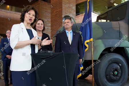 Elaine L Chao, Deb Fischer, Don Bacon. U.S. Transportation Secretary Elaine L. Chao answers questions in Omaha, Neb., as she stands with Sen. Deb Fischer, R-Neb., second right, and Rep. Don Bacon, R-Neb., right, following an announcement that the Department of Transportation will launch a pilot program to permit 18-20-year-olds who possess the U.S. Military equivalent of a commercial driver's license (CDL) to operate large trucks in interstate commerce