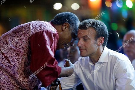 French President Emmanuel Macron, right, speaks with Femi Kuti, son of late Afrobeat legend Fela Anikulapo Kuti, left, during an event to celebrate African Culture at the New Afrika shrine in Lagos, Nigeria, . Macron arrived Abuja earlier for a meeting with his Nigerian counterpart Muhammadu Buhari, in his latest attempt to forge closer ties with English-speaking Africa