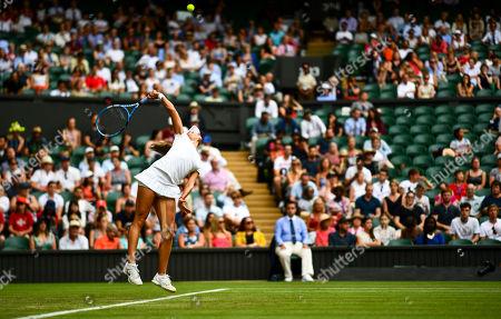 Viktoriya Tomova in action serving during her Ladies' Singles second round match