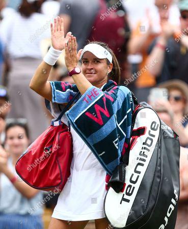 Alexandra Dulgheru applauds the fans after her Ladies' Singles second round match